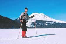 Jon Holmquist standing on frozen Sparks Lake