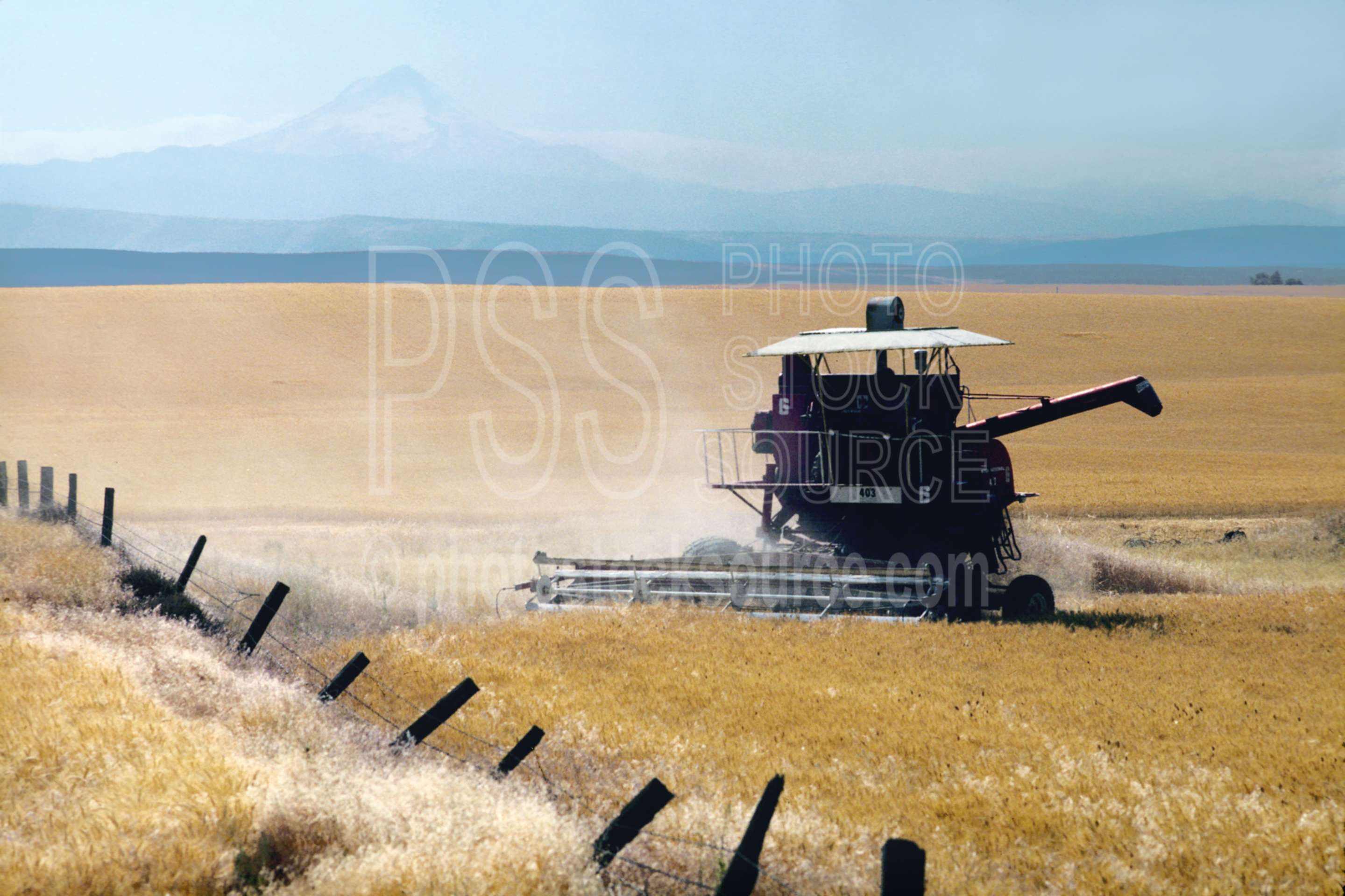Combine and Wheatfield,mt. hood,combine,harvest,wheatfield,usas,agriculture