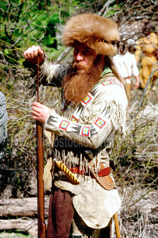 Loading His Rifle,rifle,muzzleloader,mens,mountain men,coonskin hat,coonskin,coonskin cap,usas,mountain man,frog hollar