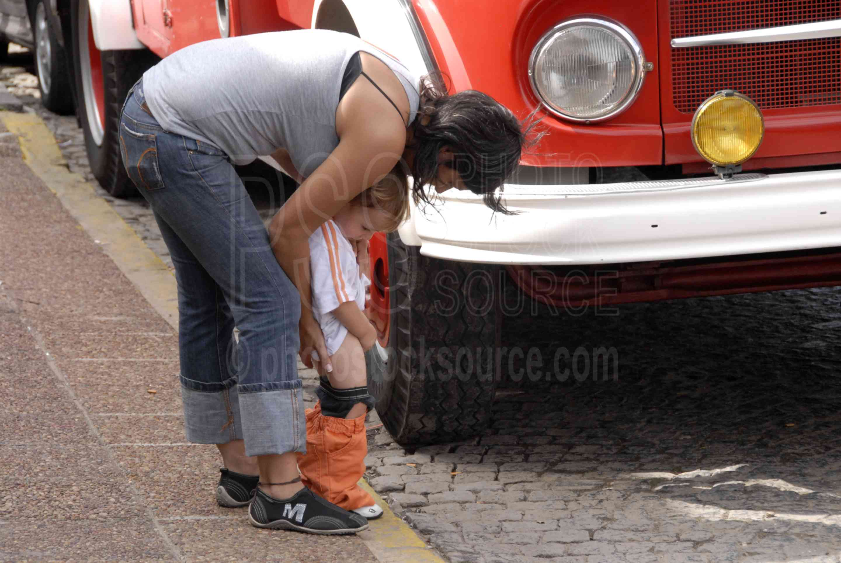 Putting out the Fire,boy,mother,pee,peeing,fire truck,truck,child,children