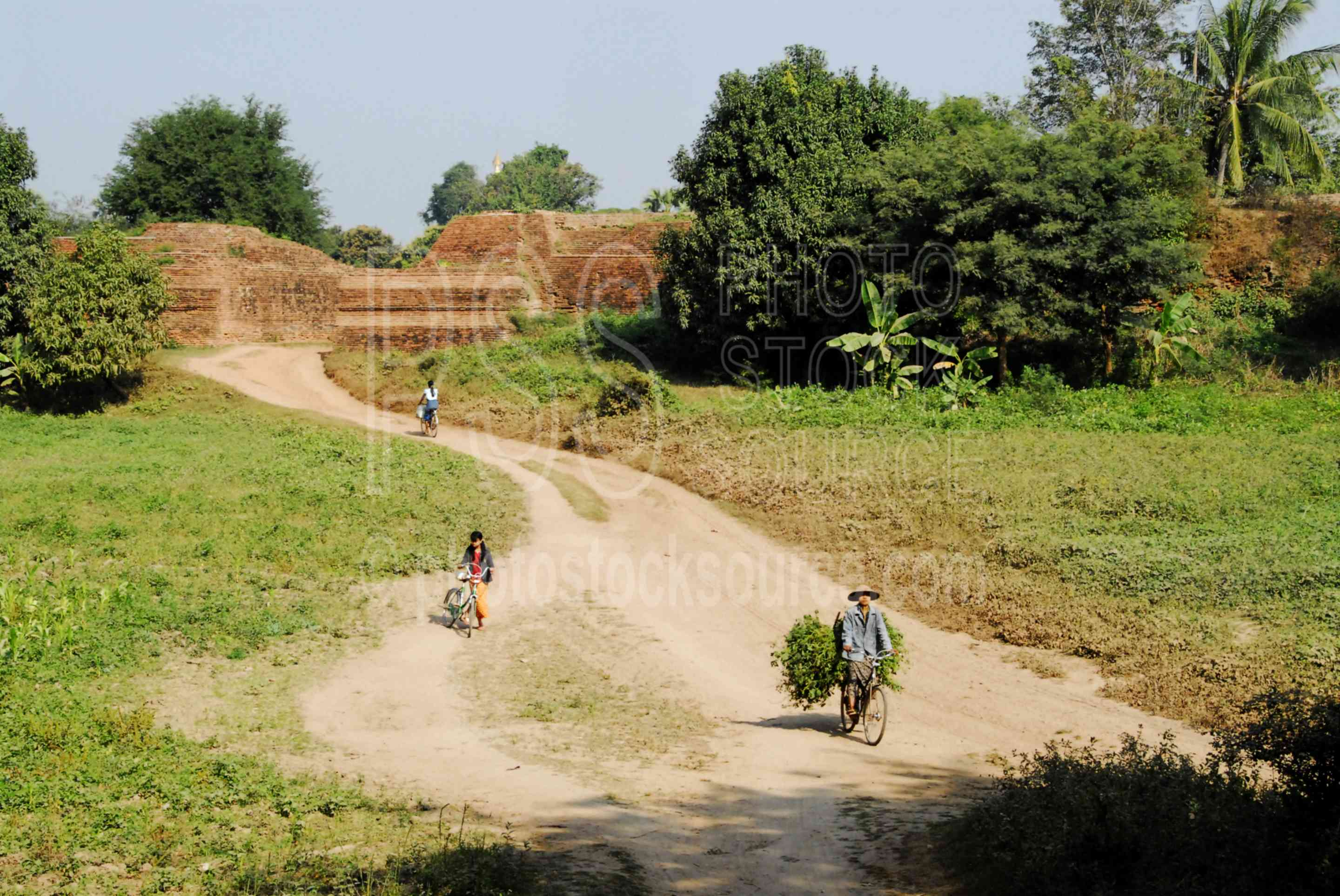 Women on Bicylcles,myanmar,woman,bike,bicycle,riding,carrying,transport,walls,fortification,gate,inwa,hathawaddy,ava