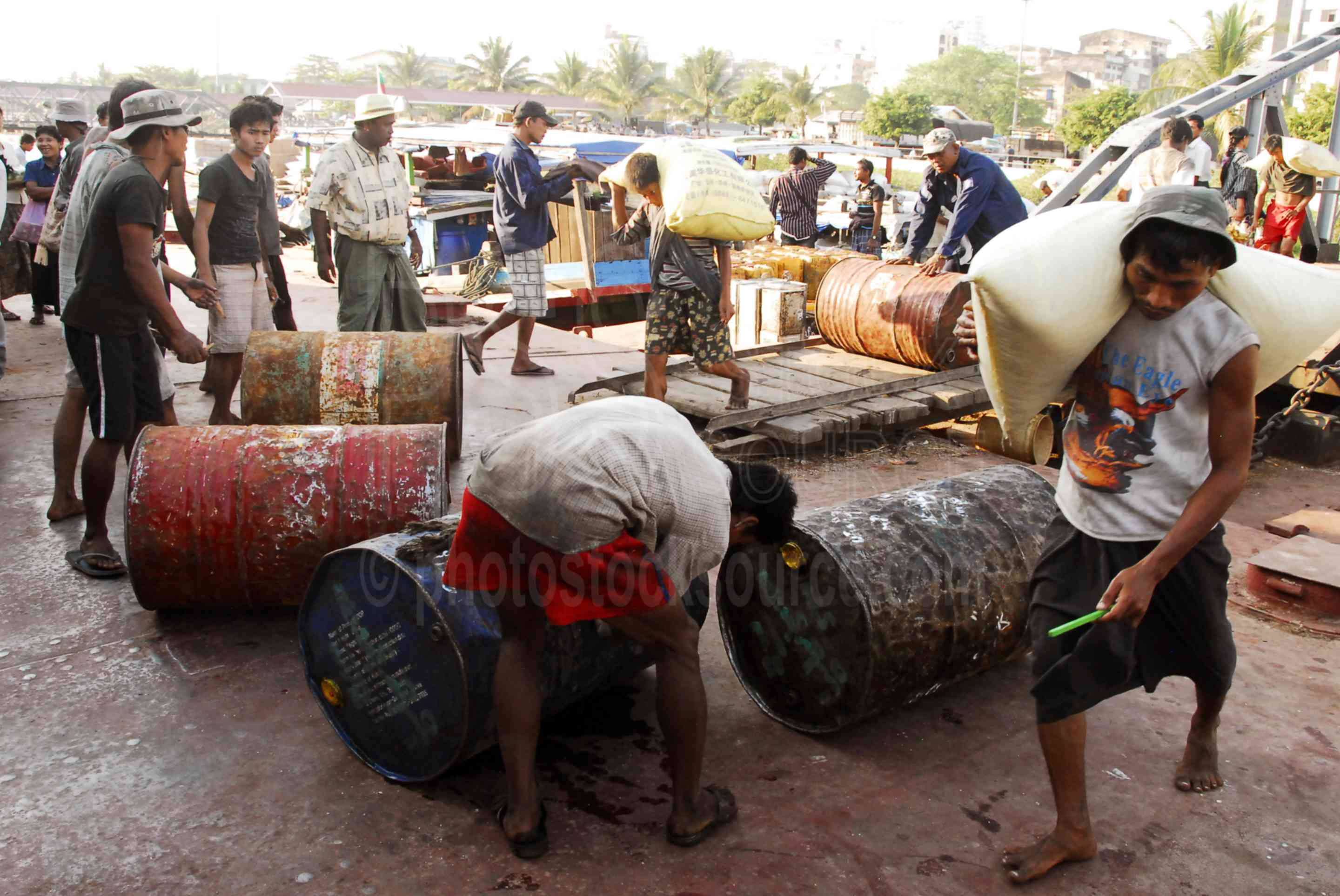Yangon Waterfront Workers,myanmar,yangoon,rangon,rangoon,wharf,waterfront,boats,ferry,jetty,yangon river,river,hlaing river,carrying,loading,cargo,barrels,fuel