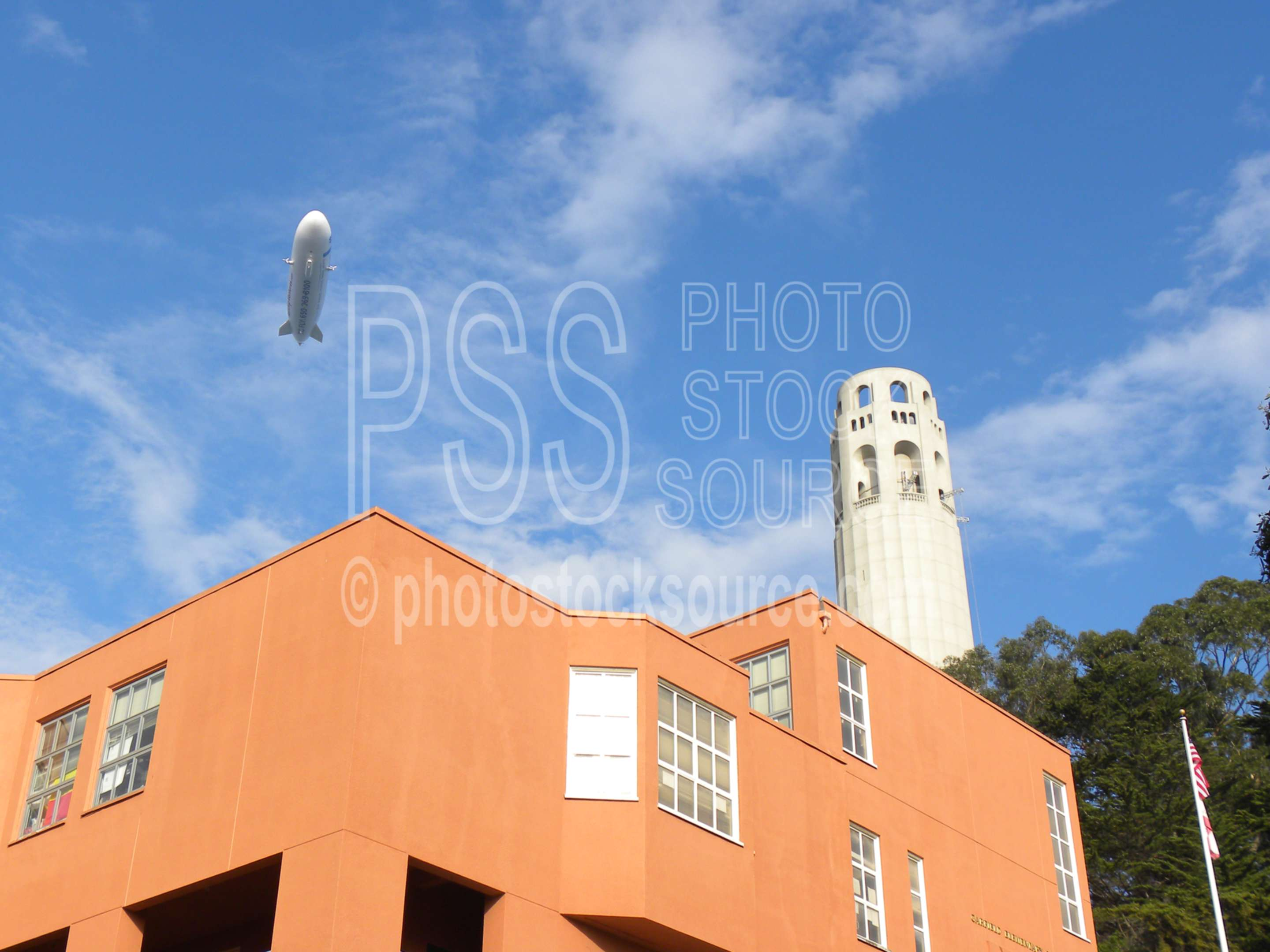 Coit Tower and Blimp,building,landmark,tower,houses,blimp,aircraft