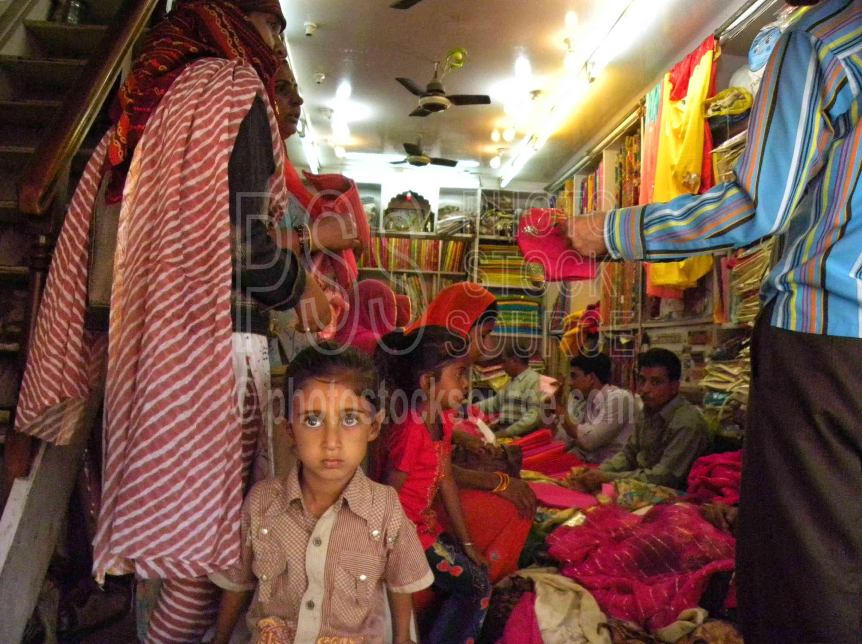 Girl in Fabric Store,girl,child,fabrics,store,shop,market