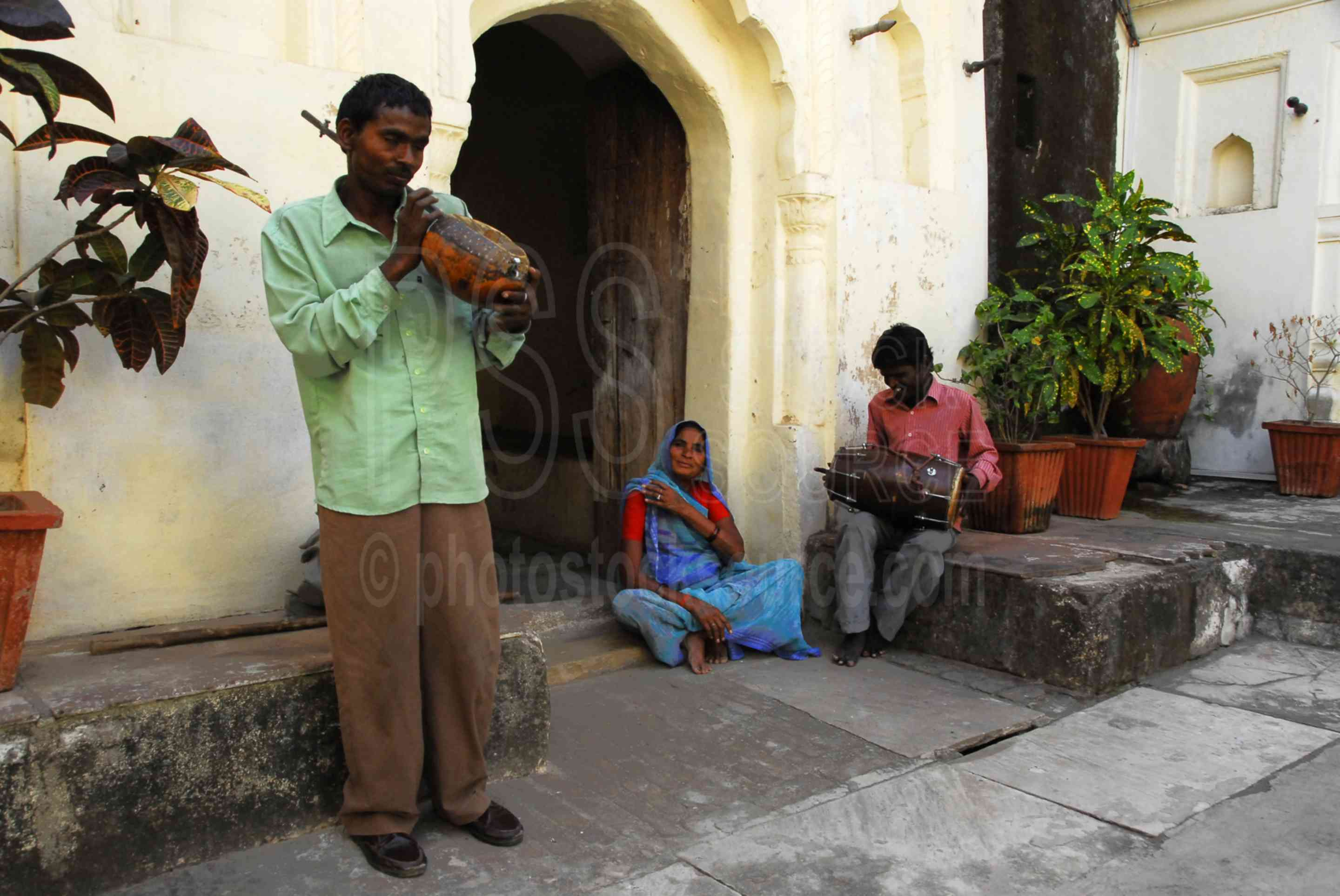 Musicians in the Courtyard,man,woman,music,instruments,courtyard