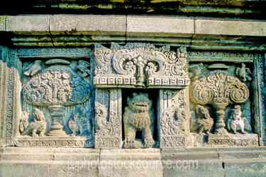 Stone Carvings - Stone carvings in the walls of the temple