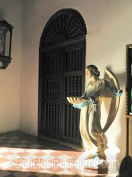 Door and Angel Statue