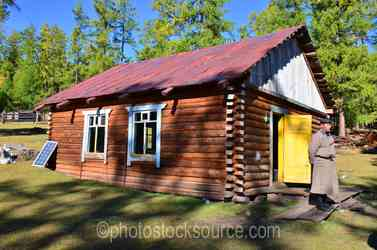 Man and  Log Cabin