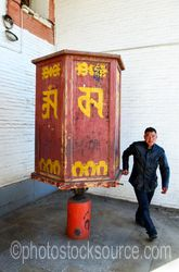 Man Turning Prayer Wheel