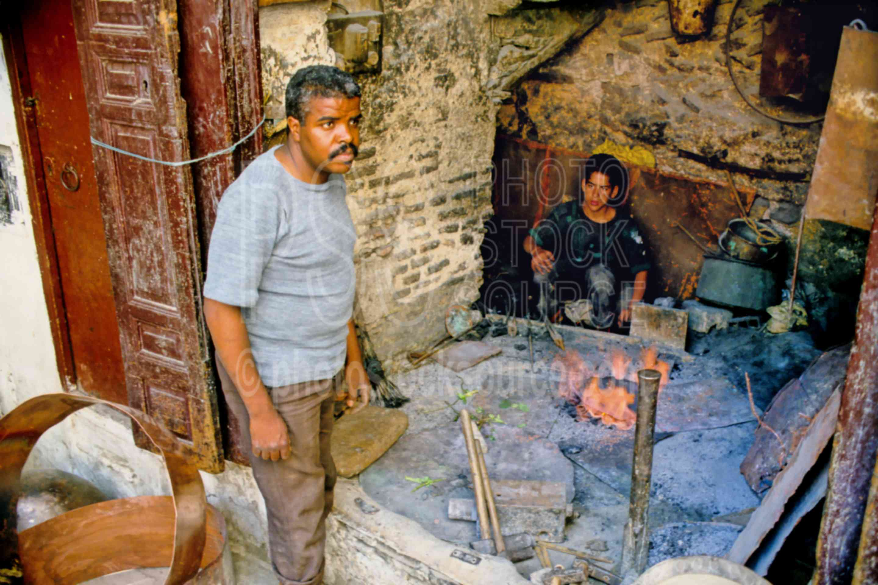 Blacksmith and Son,alley,father,fezs,market,metal,sons,street,work,worker,fezs,morocco markets