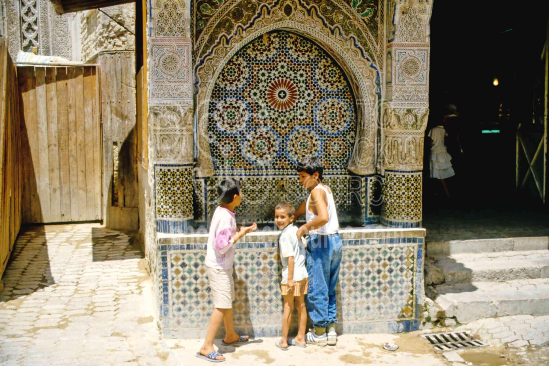 Boys at the Fountain,boys,fez,fountain,street,morocco markets,children