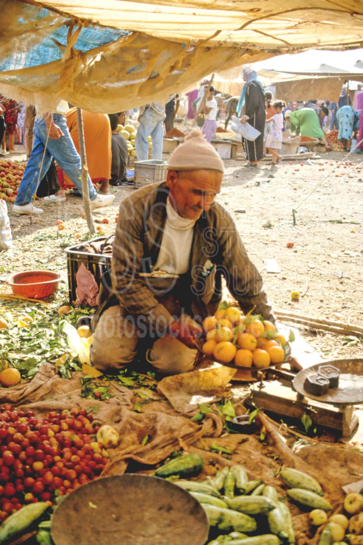 Fruit Seller,fruit,mans,market,oranges,sell,morocco markets