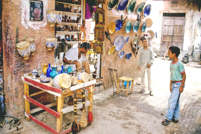 Ceramic Seller,boys,ceramics,seller,vendor,morocco markets