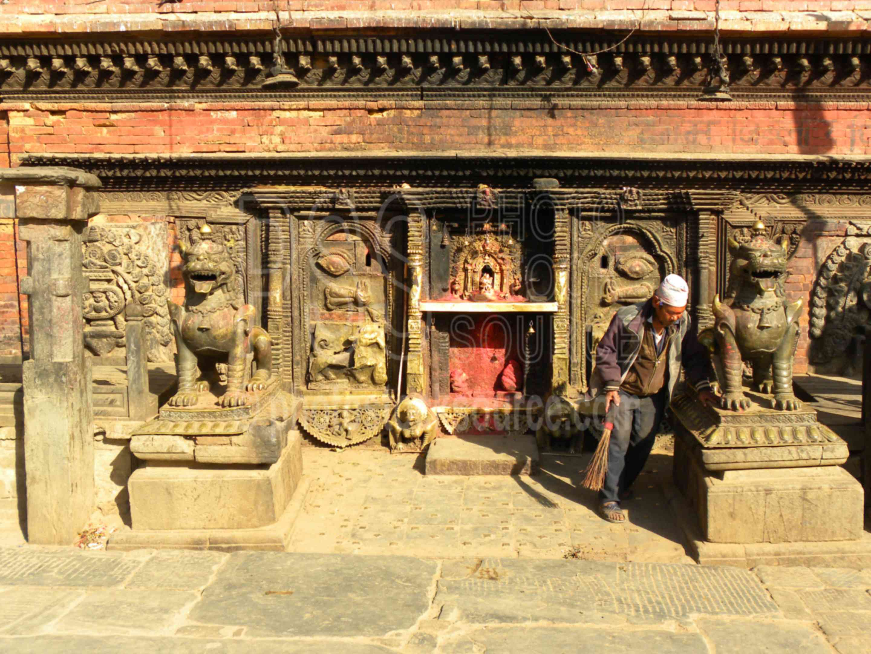 Bhairava Temple Shrine,taumadhi,square,tole,tol,pagoda,statues,bhairava,shrine,man,working,sweeping,cleaning,bhairavnath