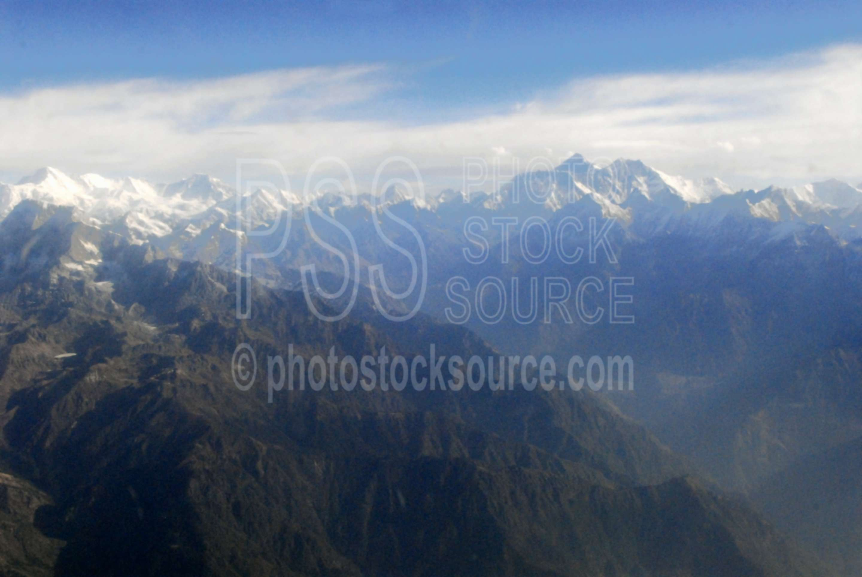Mt. Everest in the Himalayas,aerial,flying,mountains,himalayas,mountain range,nature,aerials