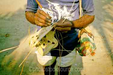 Weaving Yam Mask - Man weaving a yam mask