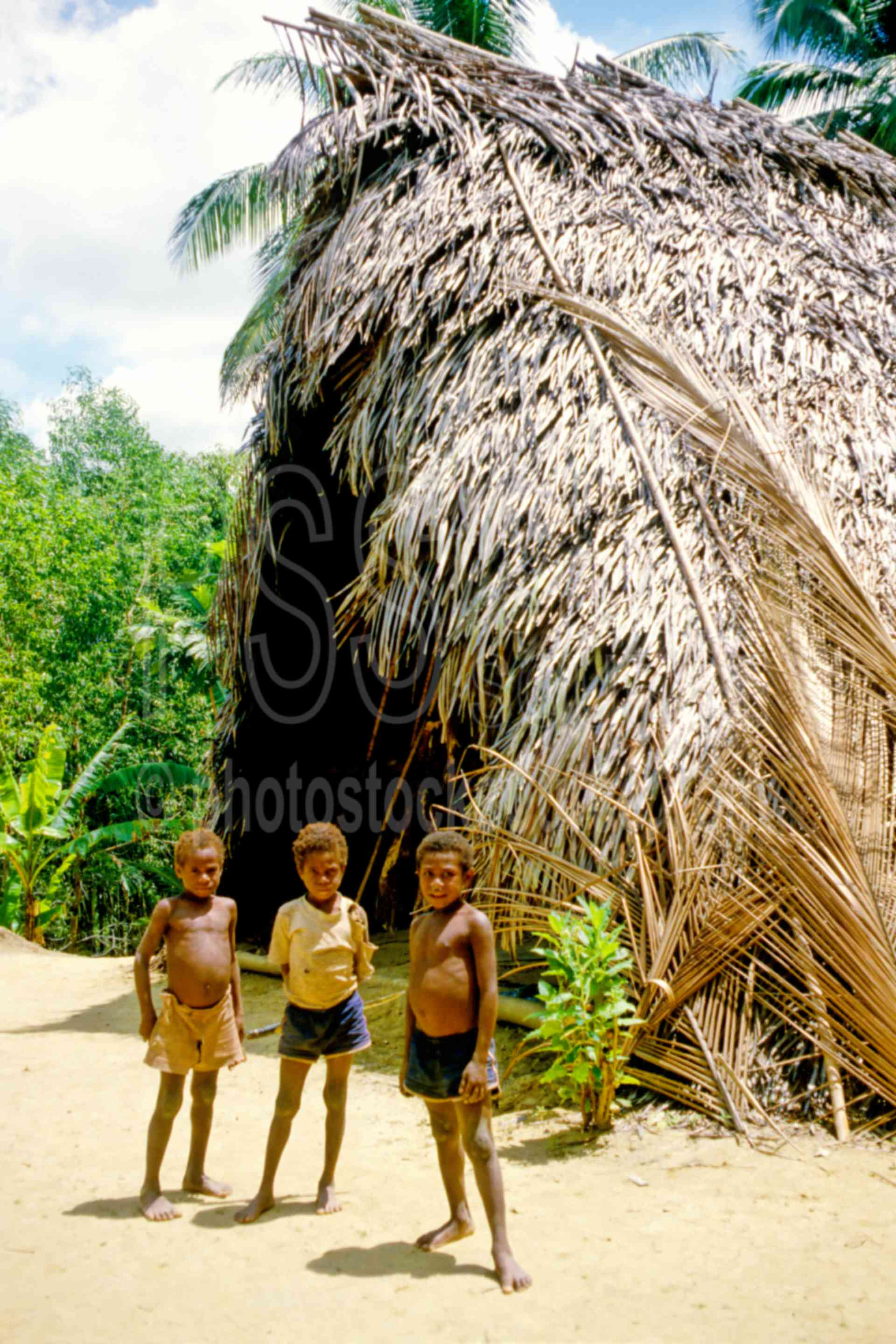 Boy in Kimbungua Village,boys,homes,huts,village,children