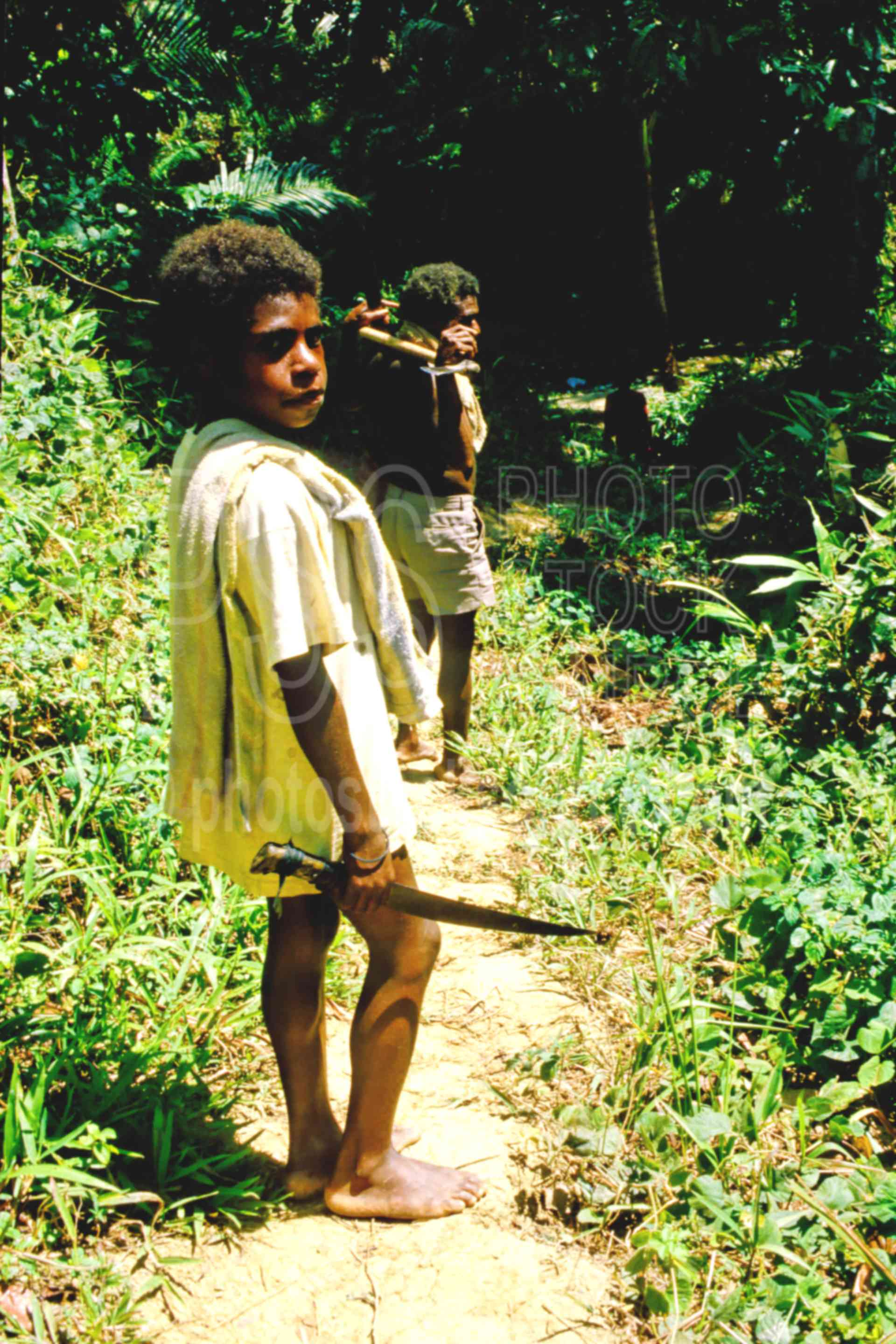 Boy with Machete,boys,bush,jungle,knife,machete,trail,children