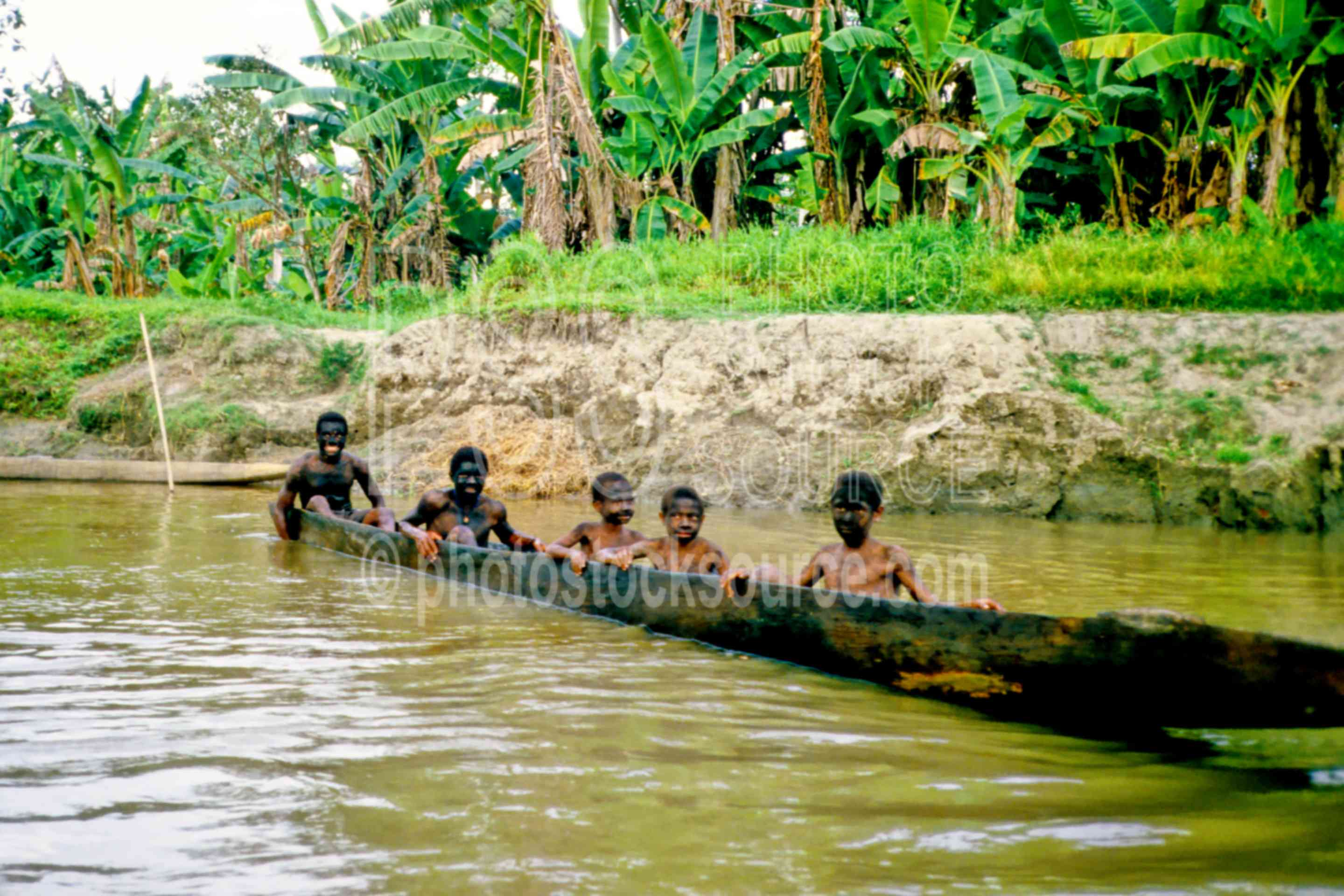 Boys in dugout canoe,boat,boys,canoe,ceremonial,river,water,lakes rivers,PNG Ceremonies,children