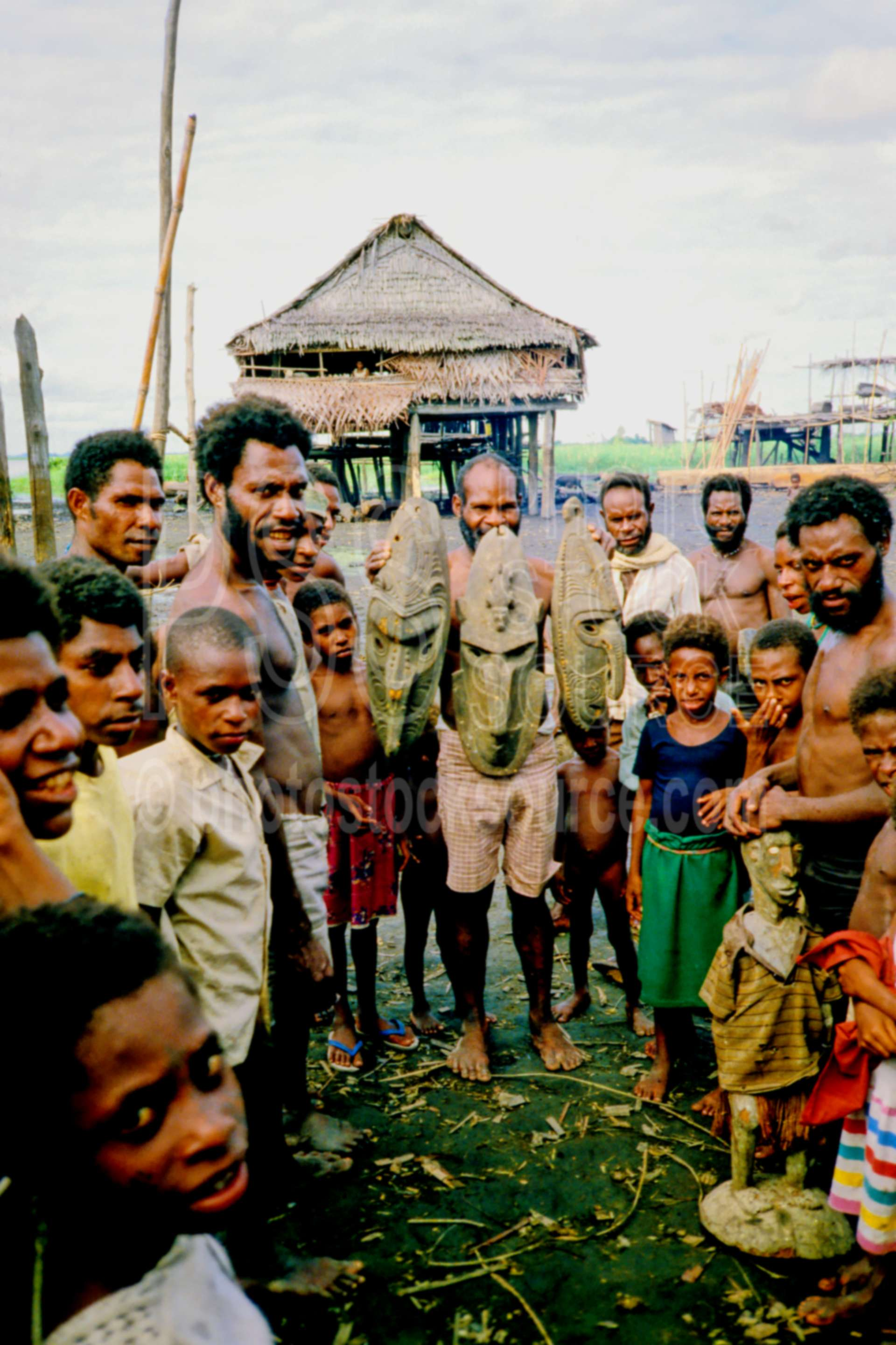 Villagers displaying artifacts,arts,artifact,carving,gathering,group,people,village,villagers,png markets