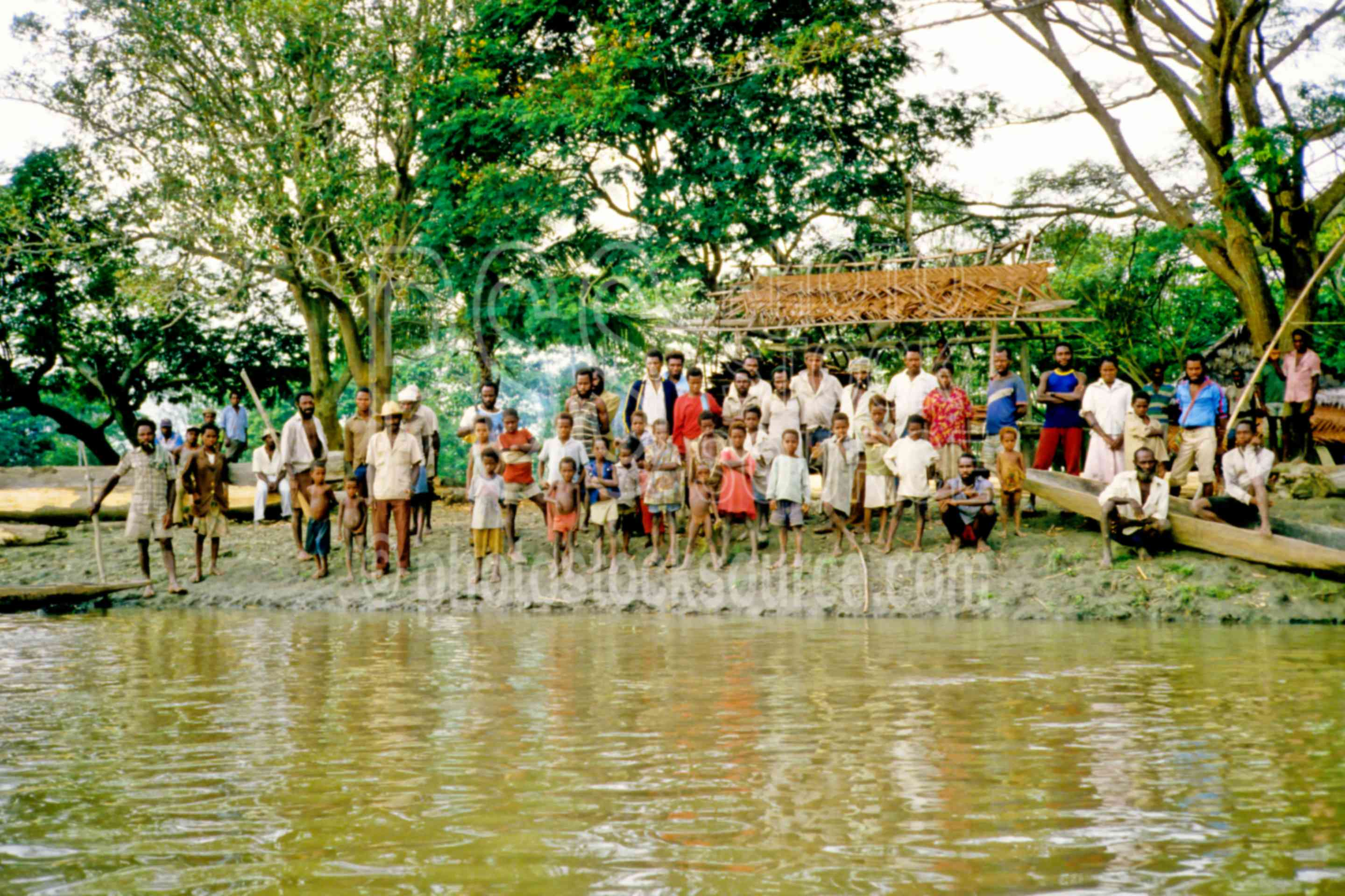 Villagers on riverbank,gathering,group,river,village,villagers,water