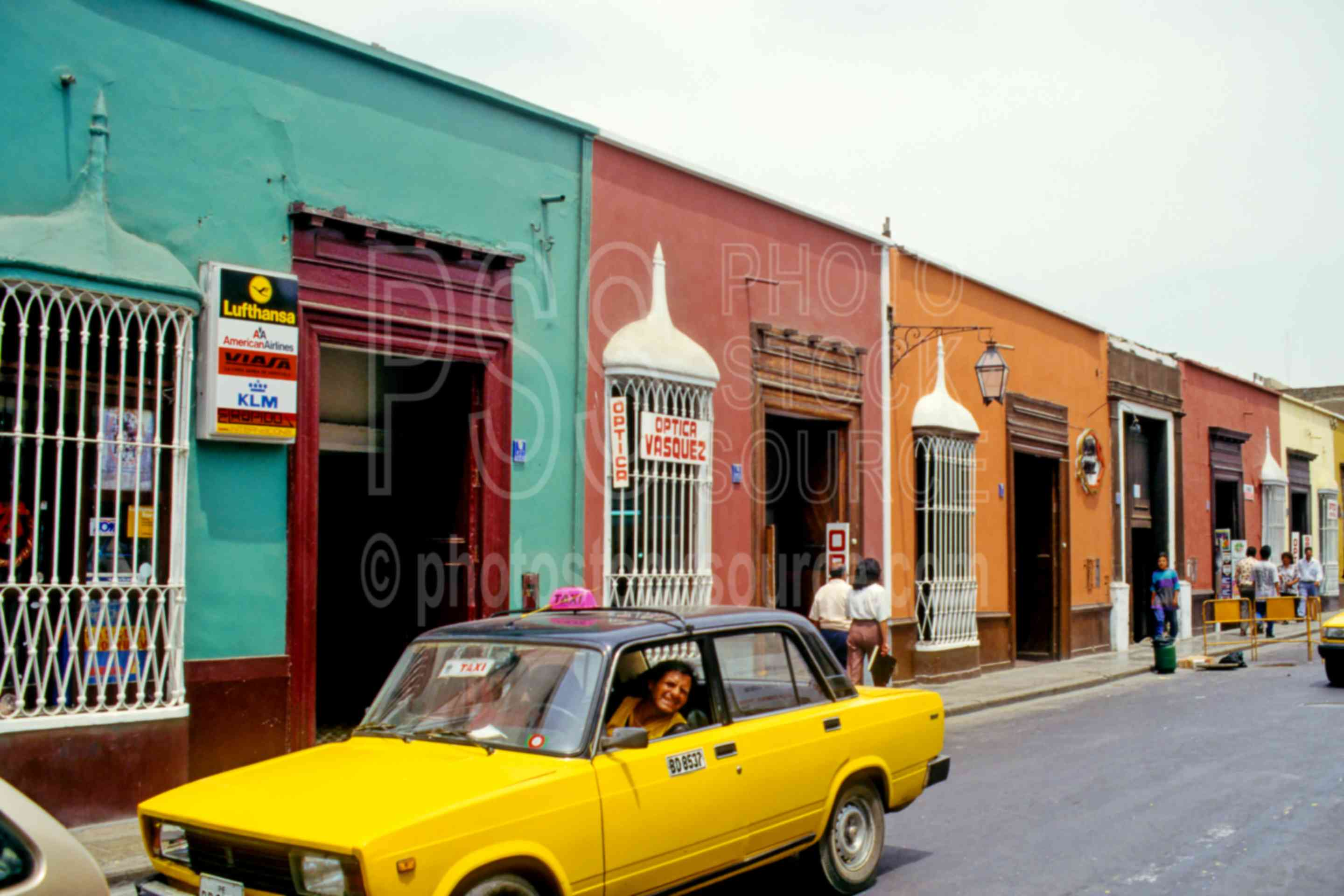 Taxi and Colorful Buildings,cars,street,taxi,automobile,automobiles