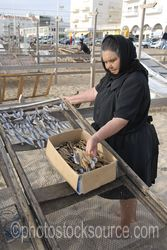 Photo of Lady Drying Fish