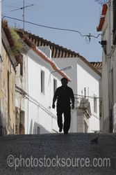 Man Walking the Street - Silhouette of a man walking down a street northwest of the castle