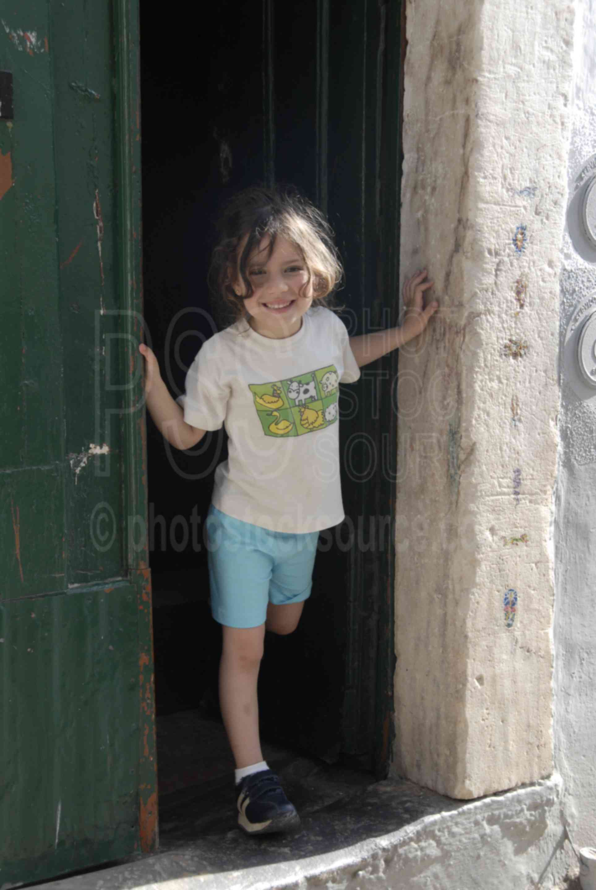 Girl in Doorway,girl,little girl,smile,smiling,children