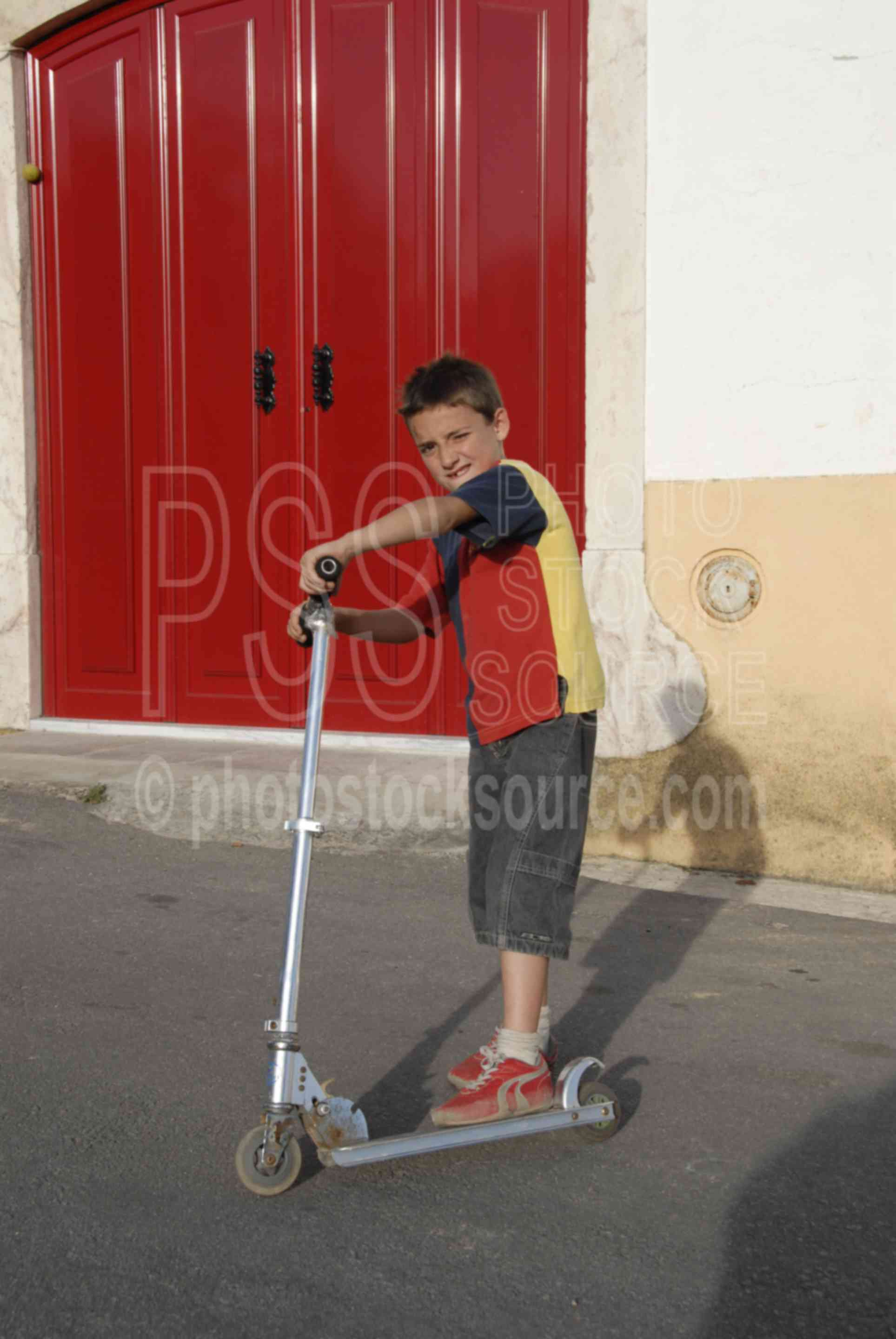 Boy on Scooter,boys,young,play,playing,scooter,children