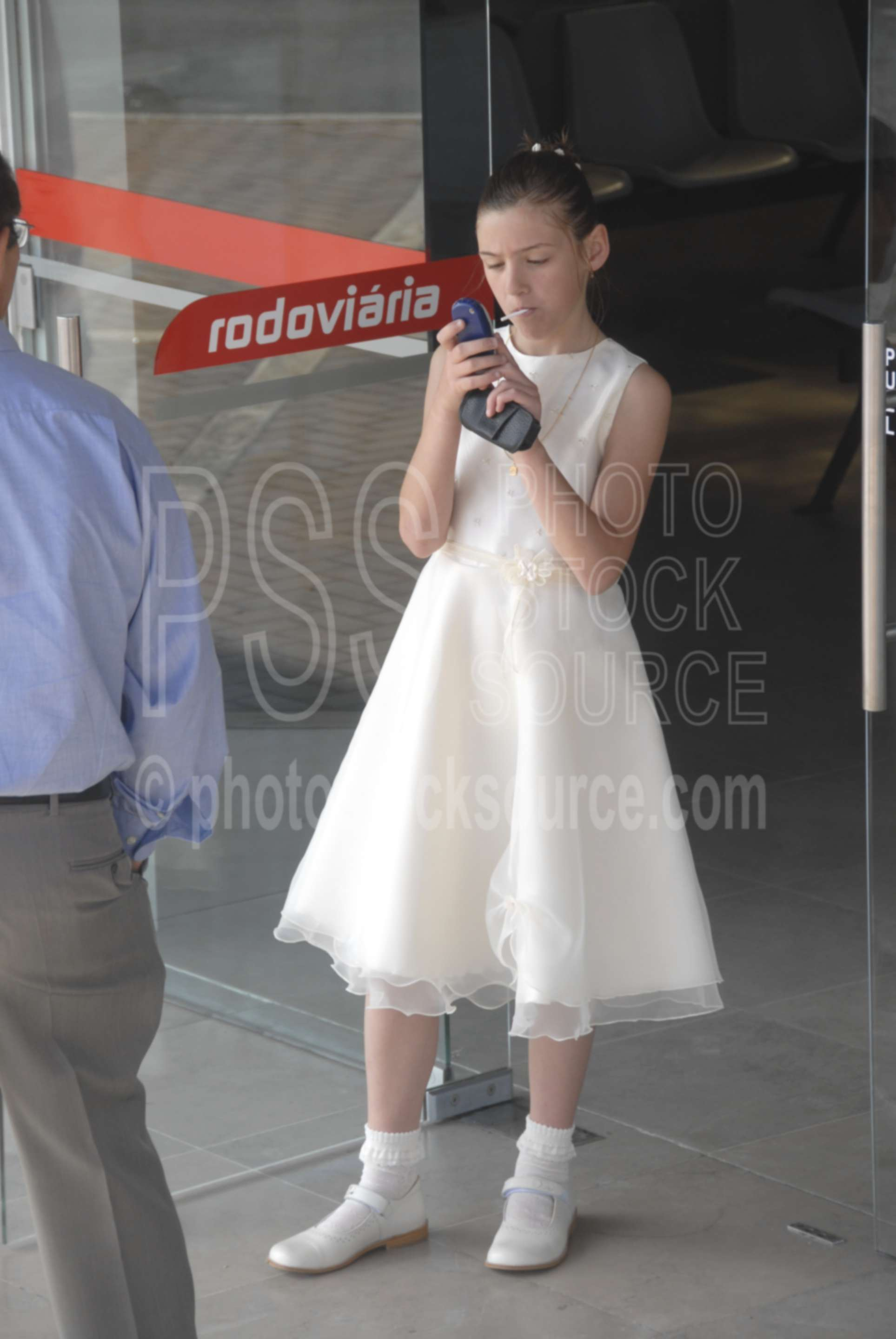 Waiting for a Bus,father,daughter,bus station,girl,young girl,cell phone,cellphone,pretty dress