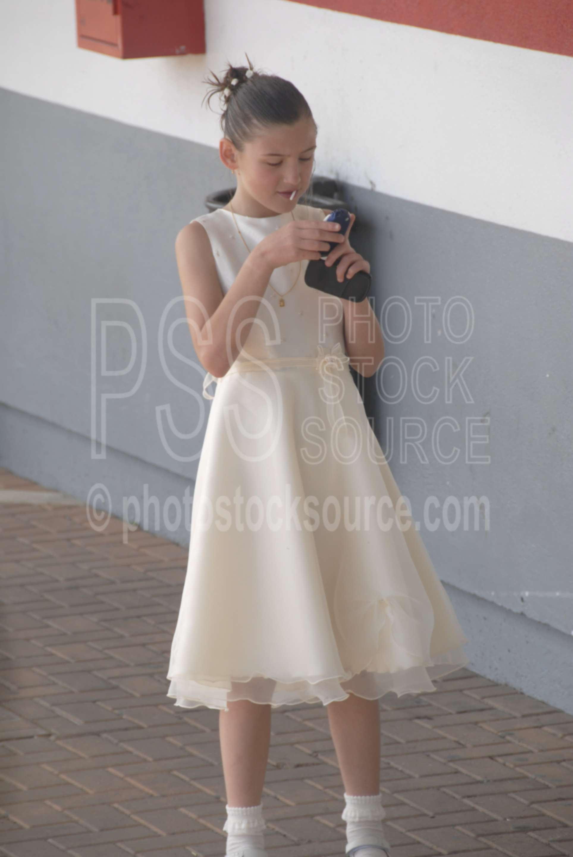 Using the Phone,father,daughter,bus station,girl,young girl,cell phone,cellphone,pretty dress