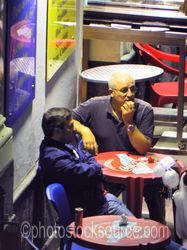 Photo of Two Men at Cafe