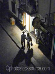 Photo of Couple Walking at Night