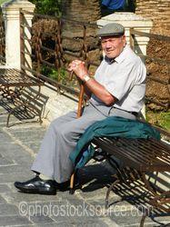 Photo of Man Sitting on Bench
