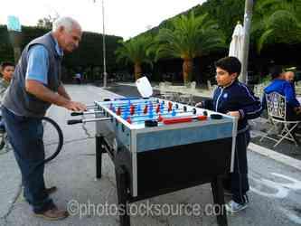 Photo of Grandfather Playing Foosball