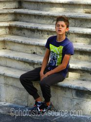 Photo of Young Man Sitting on Steps