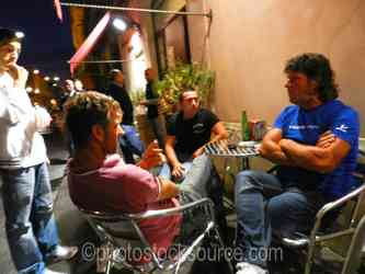 Photo of Men in Cafe at Night