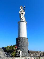 Statue Overlooking Harbor